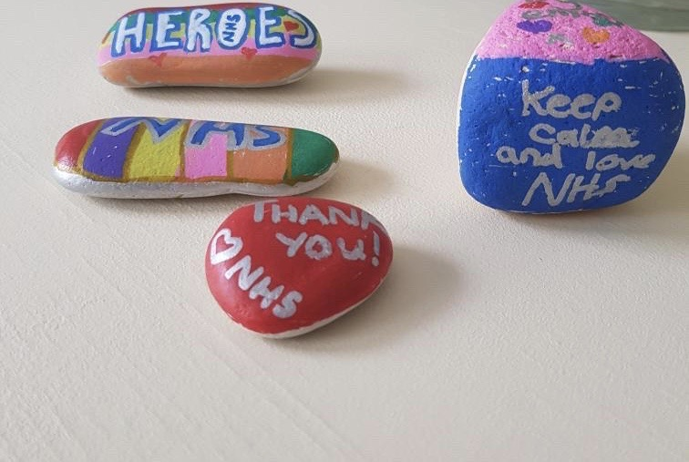 Image of decorated stones sent to the Trust to motivate staff.