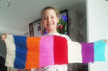 Gabrielle Rutherford holding her homemade scarf.