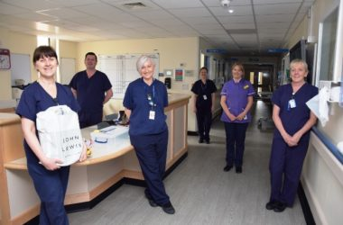 Staff in a ward smiling.